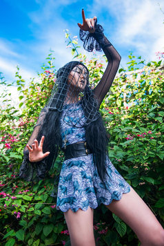 gothic fashion model with long black hair outside