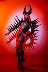 woman in black devil demon latex costume