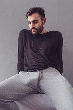 bearded man in grey sweatpants