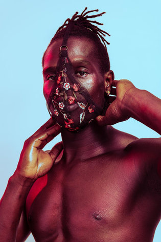 african man in floral face mask