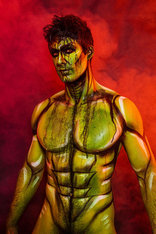 man in green comic book body paint