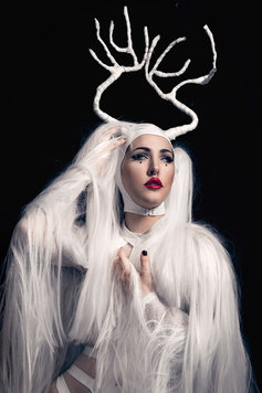 burlesque dancer as a white deer with antlers