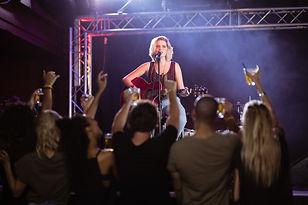 female-performer-singing-during-music-ev