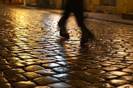 Wet cobblestones at night after rain on