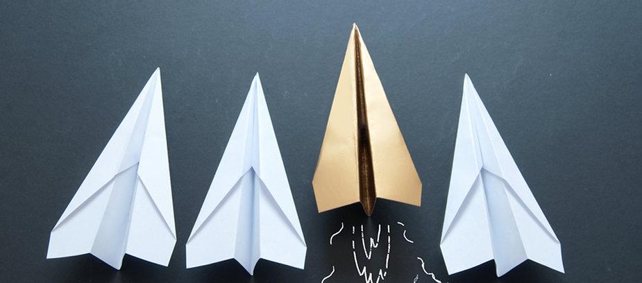 Leader concept, gold paper plane.jpg