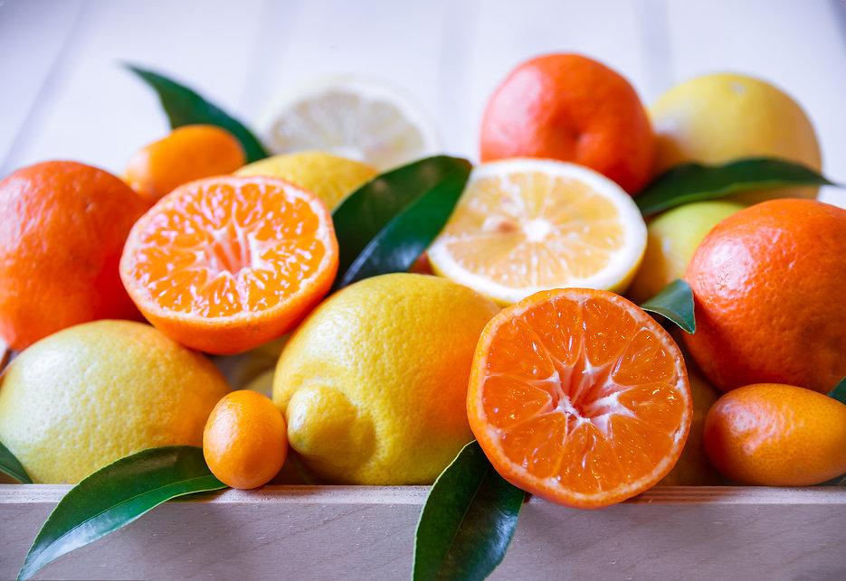 Fresh citrus fruits with leaves_ lemons, oranges, mandarins in  wooden box .jpg