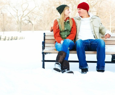 couple sitting on winter bench