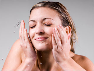 Woman double cleansing her skin
