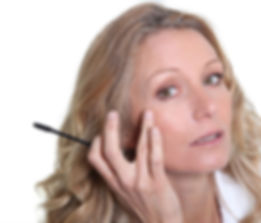 Woman applying natural makeup
