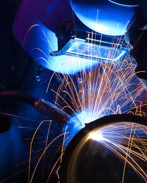 MIG welder uses torch to make sparks dur