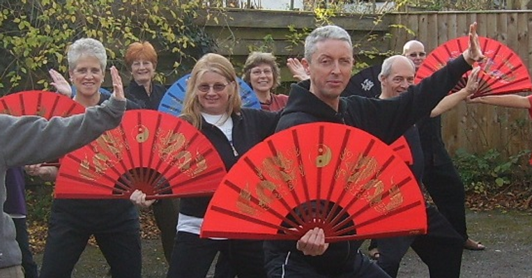 Tai Chi group photo with fan