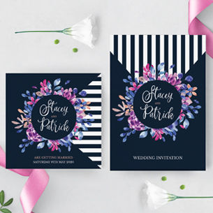 Navy and pink floral wedding stationery featuring a bold stripe pattern