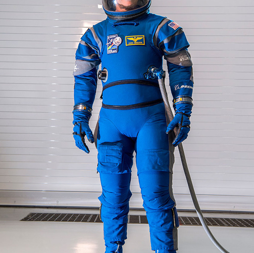 provides greater pressurized mobility and is about 40 percent lighter than previous suits. Its innovative layers will keep astronauts cooler as well. The touchscreen-friendly gloves allow astronauts to interact with the capsule's tablets while the boots are breathable and slip resistant