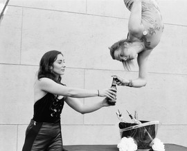 Becca Battoe opens a beer for guests with Aerialogists at the Egyptian Theatre in Hollywood