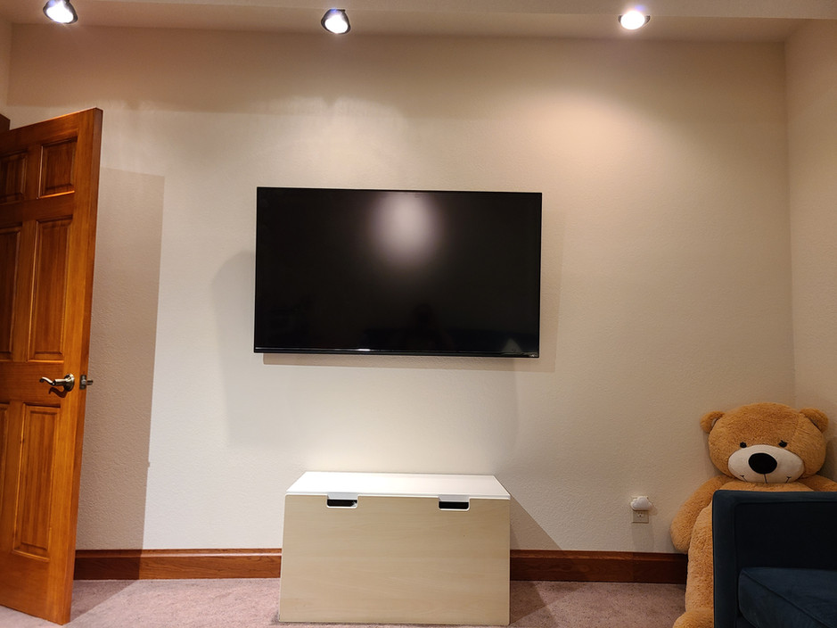 "51"" TV mounted and hung on wall"