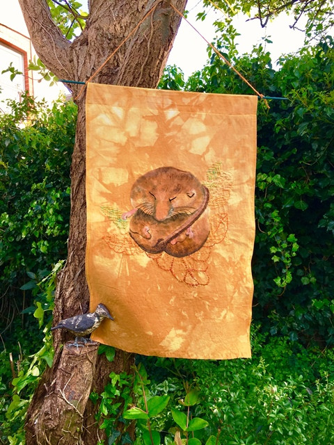 Adorably dormouse on a naturally dyed banner, textile paints and embroidery by Michelle Thomasson