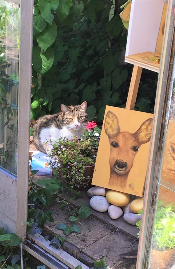 Bo, in the greenhouse with the Roe Deer Forget-me-not painting by Michelle Thomasson
