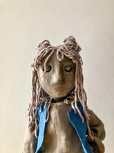 The Girl for original work, Soon.   Tabletop rod puppet