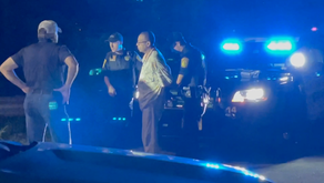 A man crashed into a police vehicle, left the scene and was charged with DUI