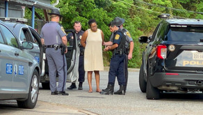 Police: Woman hit boyfriend, dragged son with car in Henry County