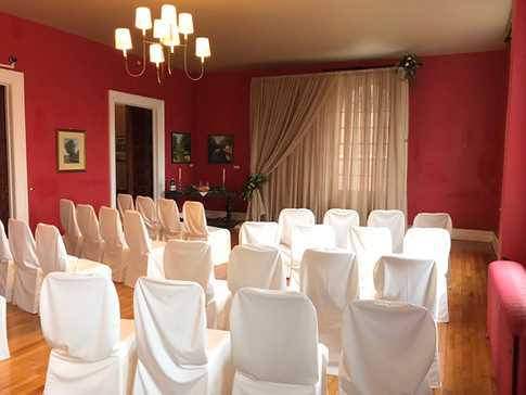 Wedding ceremnony set up in the living room of our venue facility.