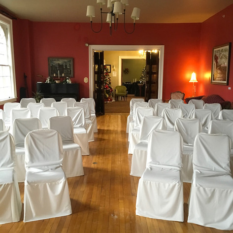 Set up for wedding ceremony in the living room of our venue facility.