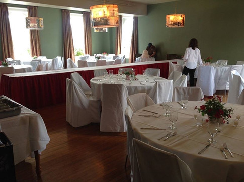 Banquet tables set up in the dining room of our venue facility.