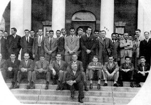 Social members sitting on the front steps of the University Club.
