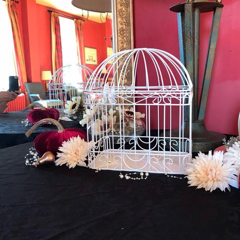 Table arrangements for a wedding reception.