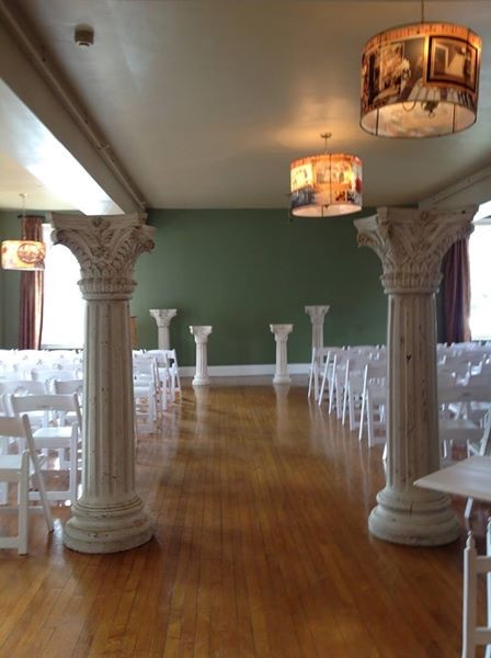 Wedding Ceremony set in the dining room of our venue facility.