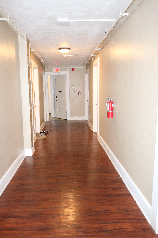 Renovated hallway with new vinyl flo