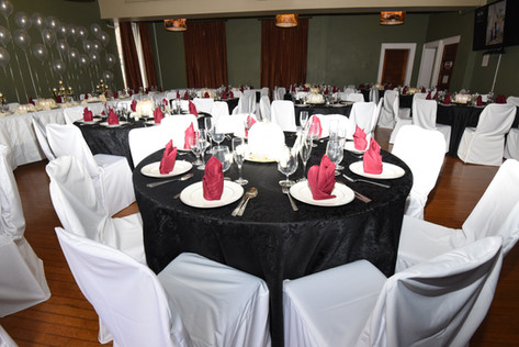 Banquet hall table arrangements for wedding reception.