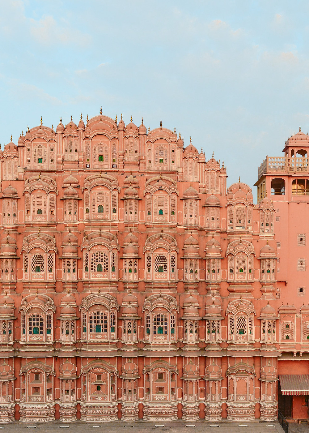 Hawa Mahal means Palace of Breeze, and is undoubtedly the city's most iconic pink facade with its stunning latticed windows. It is an extension of the Royal City Palace and was designed to allow the royal ladies to observe processions and public activities on the streets without being seen. This was during the 'pardah' era where women wore a veil to cover their faces as a social and religious practice. The small windows of the Hawa Mahal were designed in a way to keep the breeze flowing within the palace through its nine hundred plus windows. To see the famous facade in all its glory is free as it sits on a busy main road named after the palace. However, to see the rest of the palace and its grounds, a ticket is required. It is best to see and photograph the Hawa Mahal early morning or evening as otherwise it is flooded in direct sunlight.