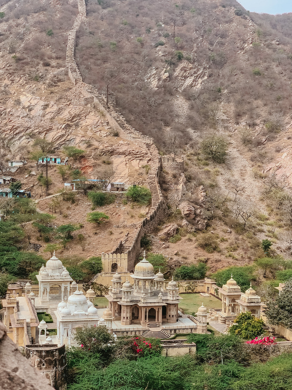 Situated in the foothills of the Nahargarh (Tiger) Fort, sits Gaitore Ki Chhatriyan. Gaitore Ki Chhatriyan is a collection of royal tombs for the Kachwaha, a Rajput clan that ruled in the area. There is a cenotaph for each of the popular maharajas cremated there, made of either sandstone or marble, topped with umbrella-shaped domes called a chhatri. The grounds are surrounded by hills and see very few visitors. It is a very peaceful and stunning site to photograph. The entry fee is 30 rupees. Keep an eye on your belongings as there are monkeys about!