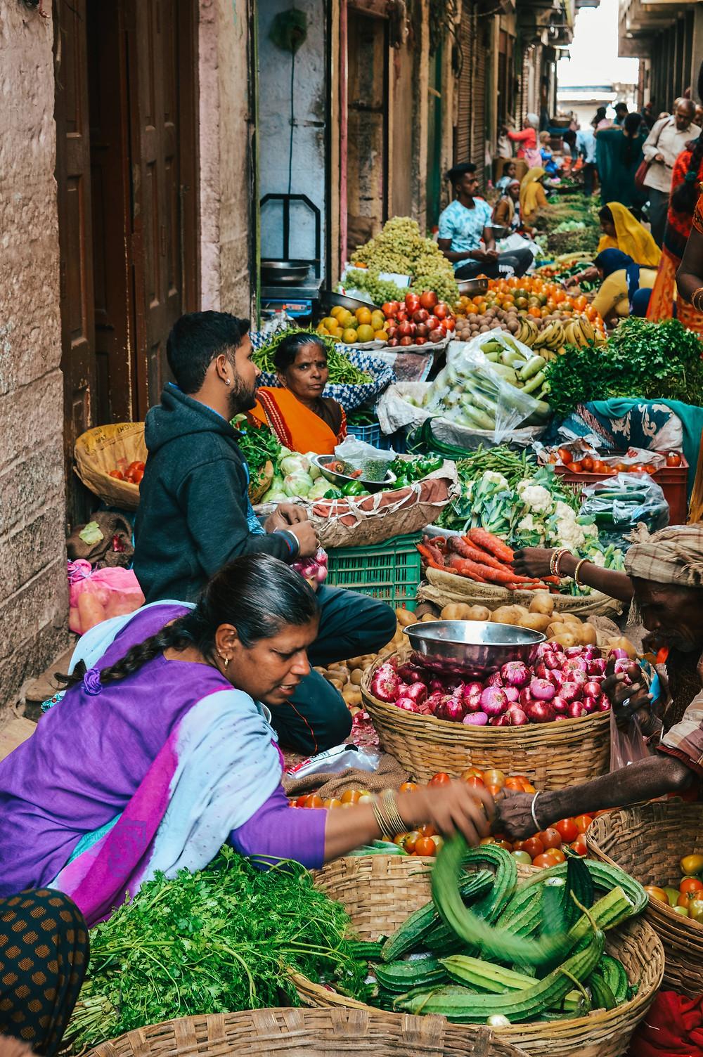 vegetable market udaipur women selling vegetables sari