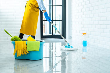 happy-young-woman-blue-rubber-using-mop-while-cleaning-floor-home.jpg