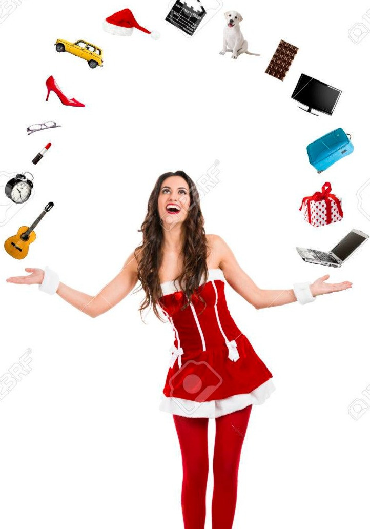 sexy and beautiful woman juggles and wears santa claus costume