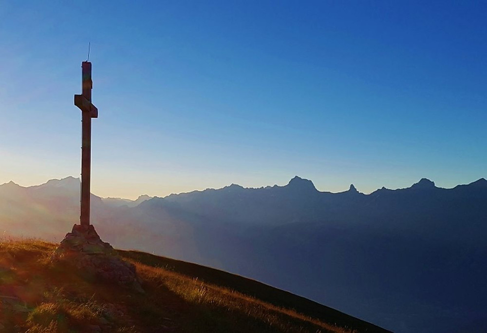 Matthew Feargrieve cross on mountain in morgins switzerland