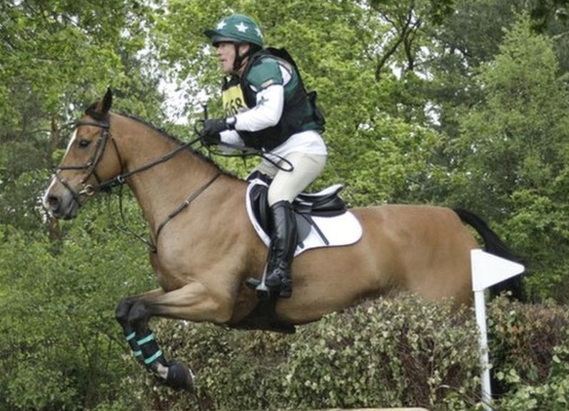 Neil Woodford manager of Woodford Equity Income Fund rides a horse over a jump at his mansion in Oxfordshire England