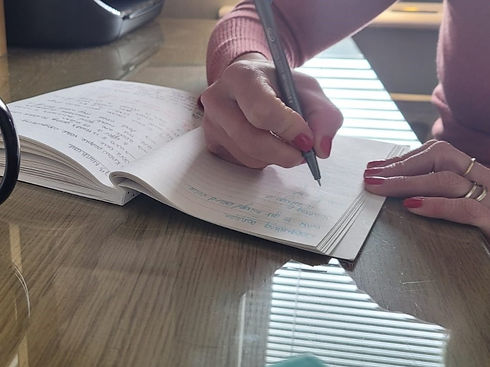 Zoe Bishop writing down initial ideas for her copywriting clients