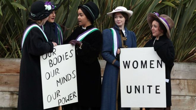 Students replicating the suffragette movement.