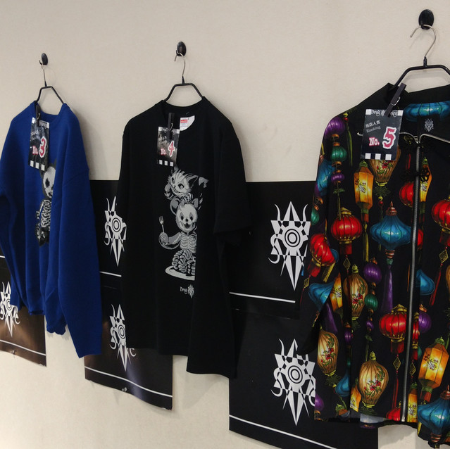 Printed shirt display! The one closest to the right had lanterns on it. I loved the colours!