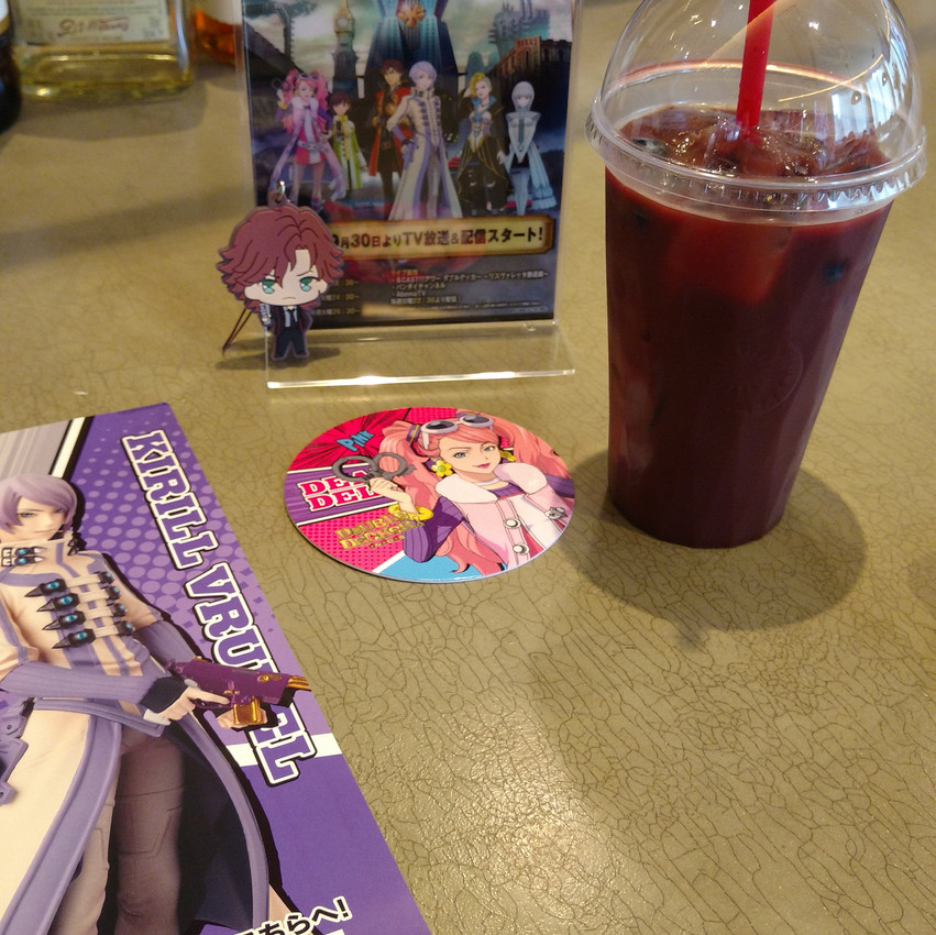 Here's what I got! I ordered the Kirill drink! It was blueberry and it tasted yummy! Each drink came with a special coaster and Im glad I got Pink!! (theres also my Doug keychain hanging out near the sign!)