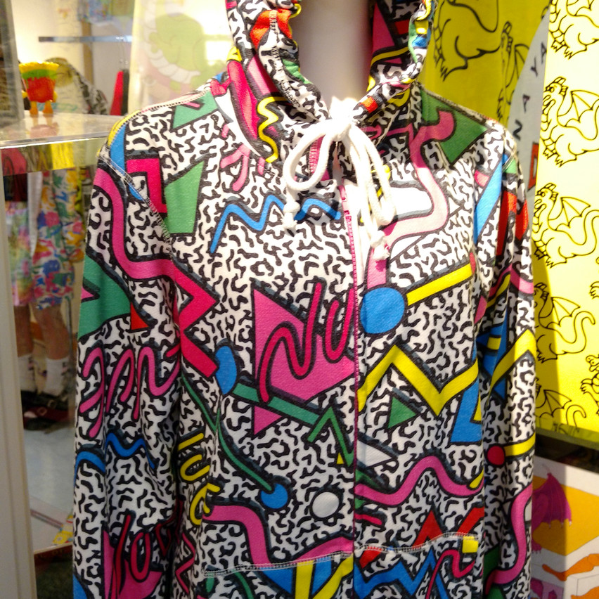 A funky, retro printed jumpsuit before you enter the shop.