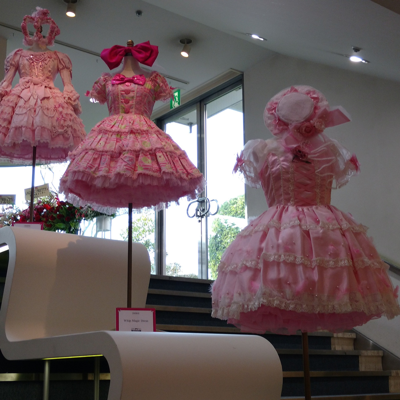 At the top floor, 3 AP dresses greet you as you walk up!