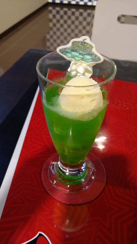 Melon soda with a scoop of vanilla ice cream.