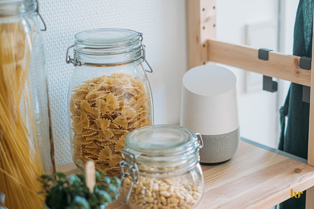 Google Home device on shelf with pasta