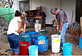 Ron Rivera mixing clay at a filter factory in Managua
