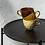Detail Beistelltisch mit schwarzem Eisengestell und brauner Mangoholzplatte