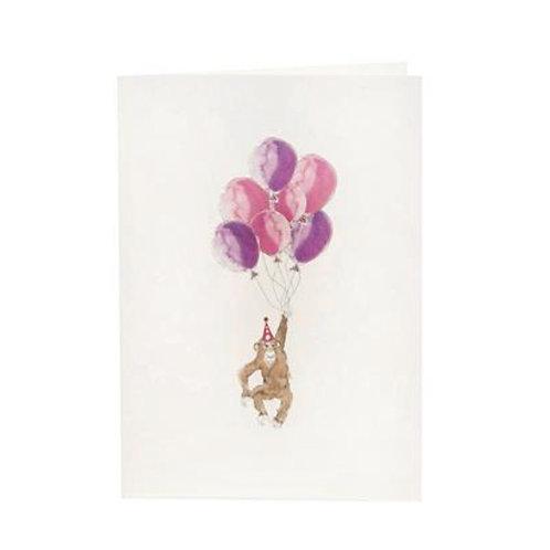 handgezeichnete Glückwunschkarte mit einem Affen und rosafarbenen Luftballons